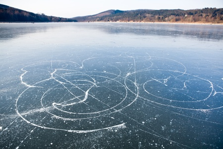 Ice skates trails on frozen lake, Brno dam Stock Photo