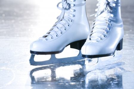 figure skates: Dramatic landscape blue shot of ice skates
