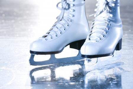 skates: Dramatic landscape blue shot of ice skates