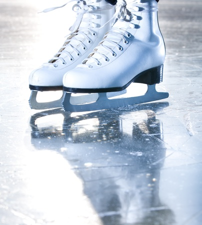 Dramatic blue portrait shot of ice skates photo