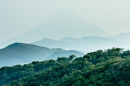 misty forest: Layered hills with Mount Kaimon (Kaimondake) in the background