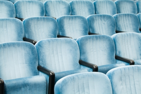 classroom training: Empty blue chairs in a conference room