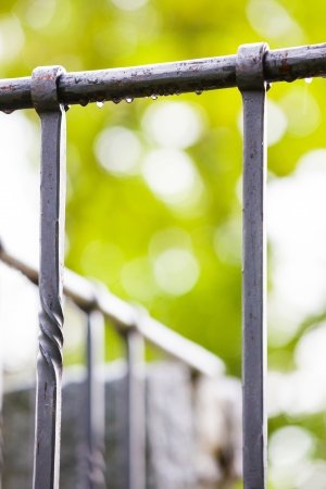 stockade: Steel fence in city park after a light rain Stock Photo
