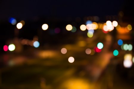 Blurred road with city lights at night Stock Photo