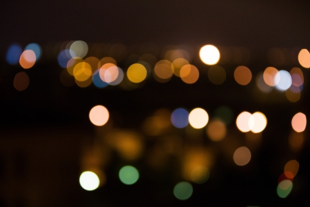 Bright night city lights blurred in distance