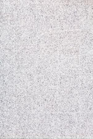 Piastrelle di marmo bianco con macchie nere su un muro Archivio Fotografico