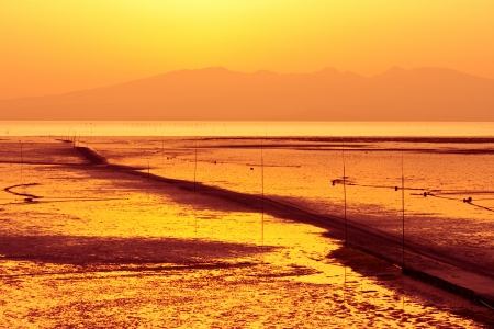 Shallow sea waters with passage in sunset photo