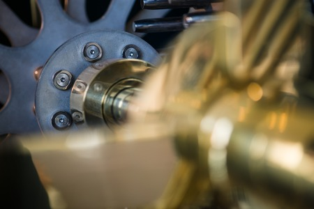 gold metal: Detail of clock internal parts, blue and gold metal Stock Photo