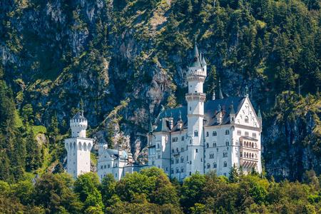 schwangau: Neuschwanstein castle in the mountains, Austria, Alps behind