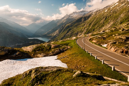 pass on: Summer view of Grimselpass with road, Alps and Raterichsbodensee