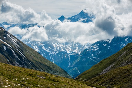Finsteraarhorn peak with clouds from Furka pass Stock Photo