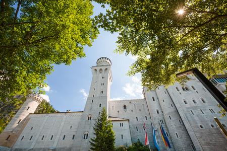 schwangau: Close view of Neuschwanstein castle with trees, Austria