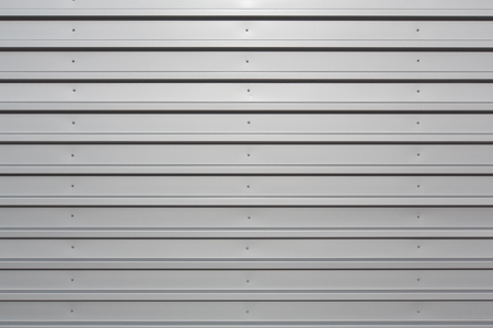 Silver corrugated metal with bolts, horizontal orientation Stock Photo