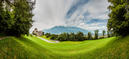 Vaduz castle, city and the Alps in a panorama shot