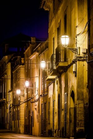 Lamps at night in the Carrer de Rafel Blanes street of the old Arta city, Mallorca