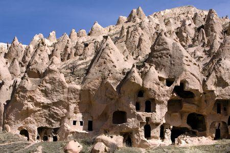 Ancient cavetown near Goreme, Cappadocia, Turkey Imagens