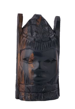 primitivism: ancient african figurine of human face, made of ebony