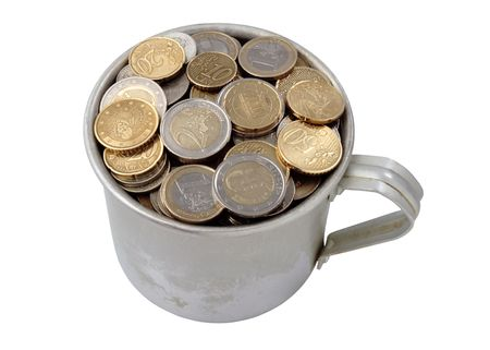 poverty relief: aluminum cup filled with coins, isolated on white background. Stock Photo