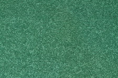 texture of a green  carpet with short  pile.
