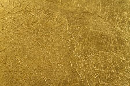 foil: consistenza del muro, coperta da una sottile lamina d'oro, con belle pieghe e fessure Archivio Fotografico