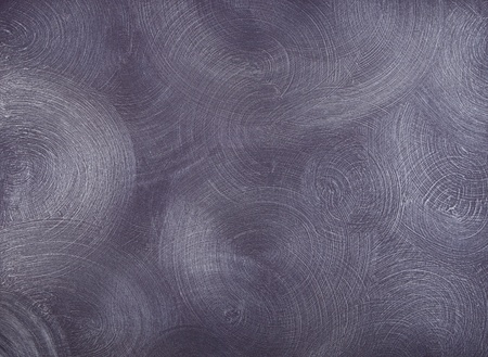 centric: texture of the walls covered with purple paint, with frequent, round, centric strokes.