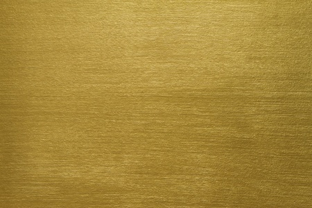 gold texture: texture of a cement wall covered with gold paint with long strokes Stock Photo