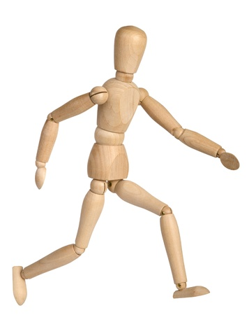 wooden toy symbolizing of the running man Stock Photo