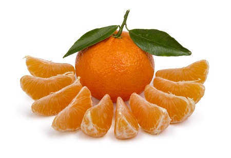 ripe tangerines with  leaves and segments on a white background photo