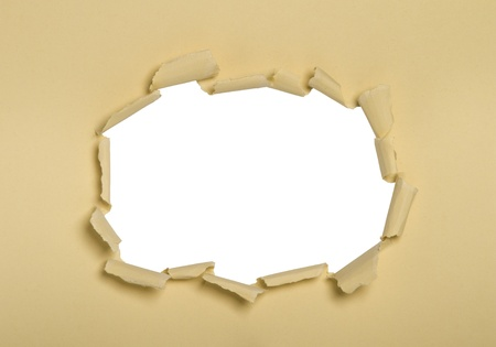 breaking through: a hole punched into cream paper, white center.