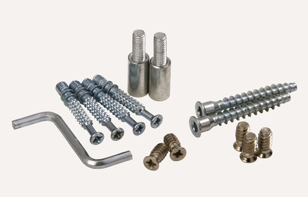 assemblage: Set of modern bolts and screws for furniture assemblage, isolated on white.