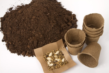 pile of soil and peat pots for seedlings and seeds photo