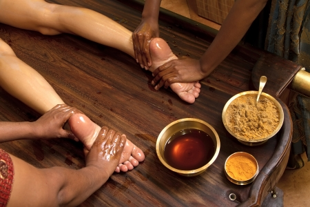 indian doctors doing traditional ayurvedic oil foot massage Stock Photo - 10182364