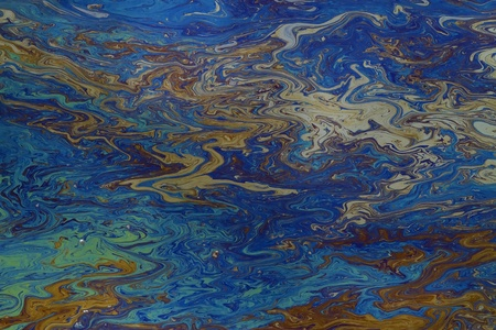 to smear: background of an oil slick on water showing the brilliant colors Stock Photo