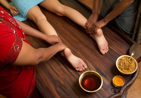 indian doctors doing traditional ayurvedic oil foot massage Stock Photo - 10420156