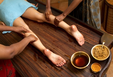 indian doctors doing traditional ayurvedic oil foot massage Stock Photo - 10420169