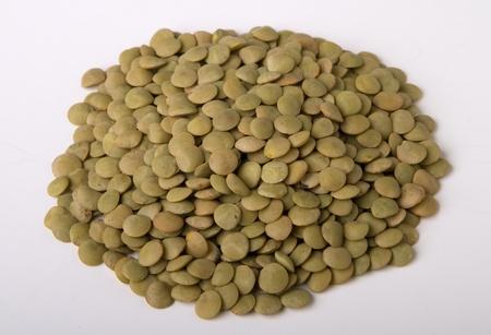 heap of green lentil isolated on white.