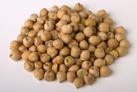 heap  of  yellow dried peas isolated on white. photo