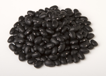 green bean: heap  of black  dried beans isolated  on white. Stock Photo