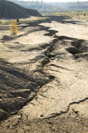 ravine: deep crack, ravine in the abandoned sand quarry Stock Photo