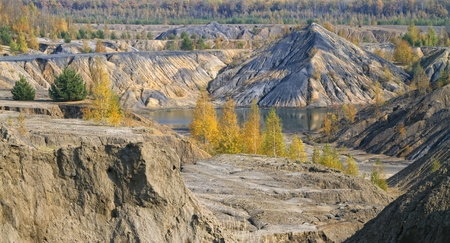 sand quarry: panorama of autumn forest with sand hills and lake