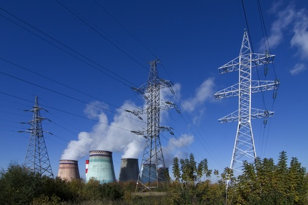 global cooling:  high voltage power pylons on against a thermoelectric plant Editorial