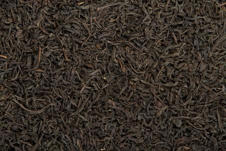 dried leaf:  selective big leaf black  tea as a background