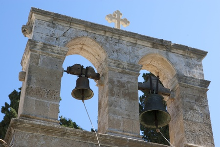 church bells: fragment of an ancient, Greek church with bells Stock Photo