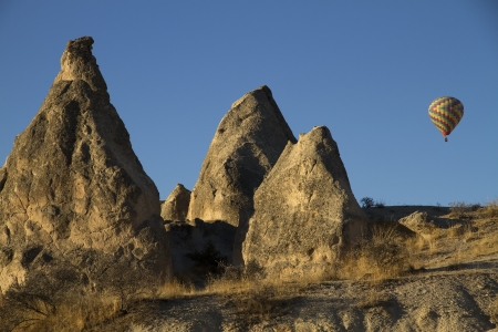 Hot Air Ballons Flying over Cappadocia Rocks Turkey photo