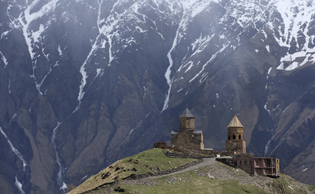 monastery nature: 14th century Holy Trinity Church (Tsminda Sameba) near Mount Kazbek in Georgia