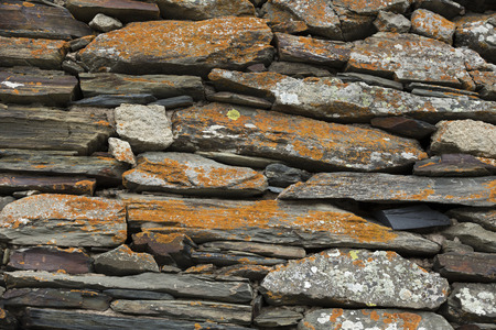 basalt: Wall composed of different pieces of basalt covered with lichens