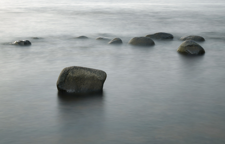 coastlines: Stones in the Water at Evening Sun, Long time Exposure