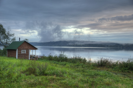 finland sauna: Vintage Russian smoke sauna log cabin on a river shore.