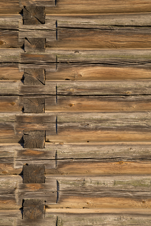 building feature: Old Log Cabin Wall Texture. Dark Rustic House Log Wall. Horizontal Timbered Background.