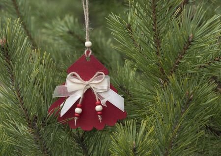 Homemade wooden Christmas decorations for the Christmas tree. Traditional christmas hand made decoration hanging on fir tree. Imagens